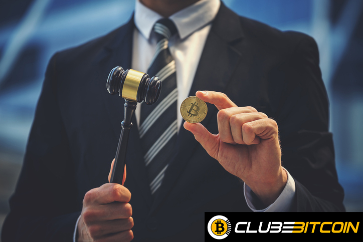 Bitcoin and judge gavel in hand